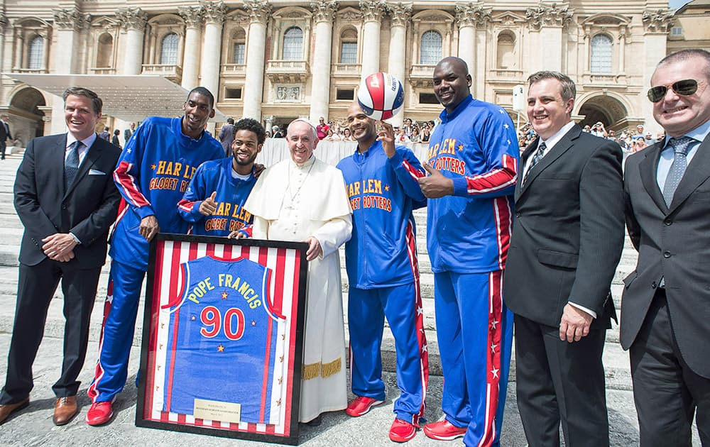 Harlem Globetrotters' Hi-Lite Bruton, Ant Atitkson, Pope Francis, Flight Time Lang and Big Easy Lofton pose for a family picture as they meet during the general audience in St. Peter's Square at the Vatican.