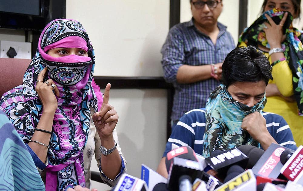 The woman who has approached Delhi, Commission for Women against AAP leader Kumar Vishwas, speaks to the media along with her husband in New Delhi.