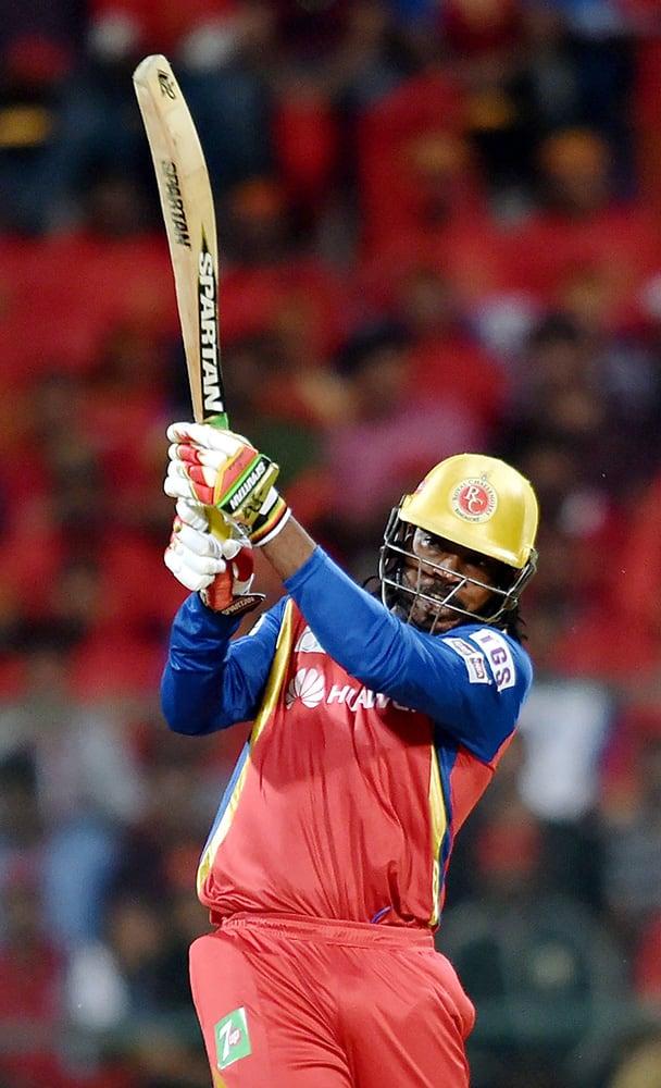 Royal Challengers Bangalore player Chris Gayle plays a shot during IPL 8 match against Kings XI Punjab in Bengaluru.