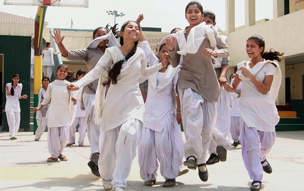 Students celebrate their success after announcement of Haryana Board class 10th and 12th results, in Gurgaon.