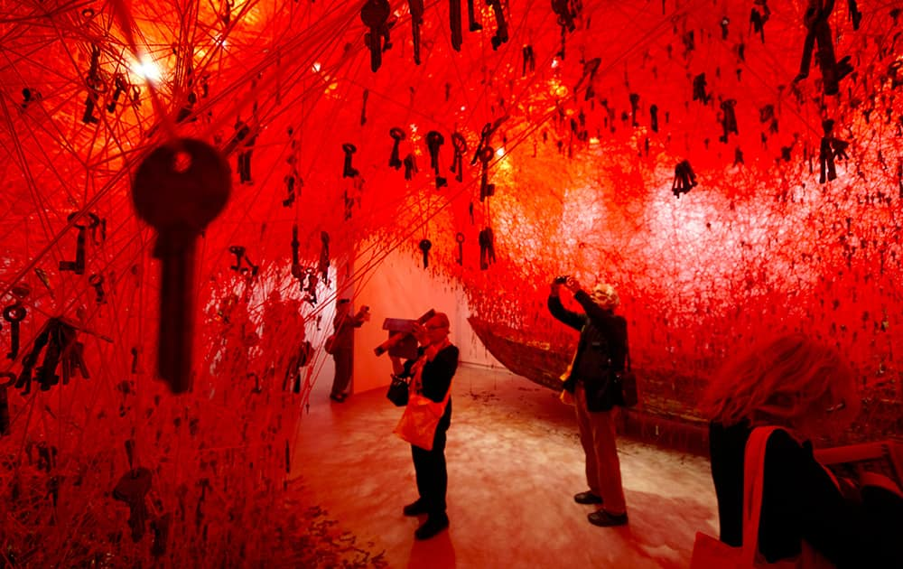 Thousands of keys hang in the Japanese pavilion part of Japanese artist Chiharu Shiota installation 'The Key in the Hand' at the 56th Biennale of Arts in Venice.