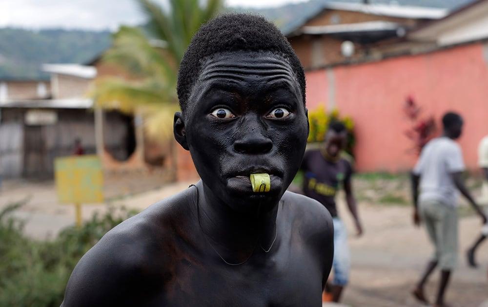 A Demonstrator blows his whistle in the Kanyosha district of Bujumbura, Burundi.