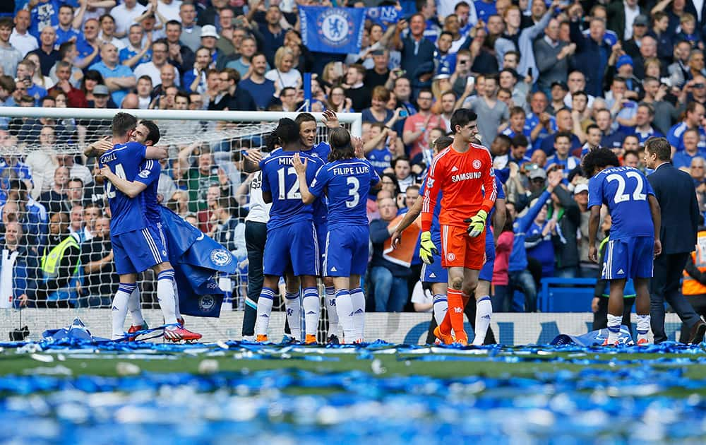 Chelsea players celebrate after the English Premier League soccer match between Chelsea and Crystal Palace at Stamford Bridge stadium in London.