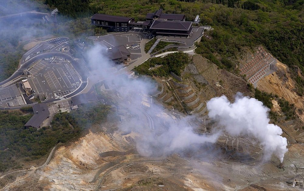 White smoke is spewed out in Owakudani valley of Mount. Hakone where increased earthquake activity is found, in Hakone town, about 80 kilometers (50 miles) southwest of Tokyo.