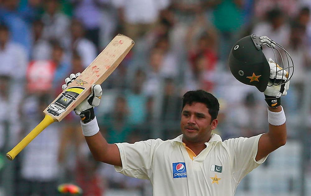 Pakistan's Azhar Ali celebrates after scoring a double century on the second day of the second test cricket match against Bangladesh in Dhaka.