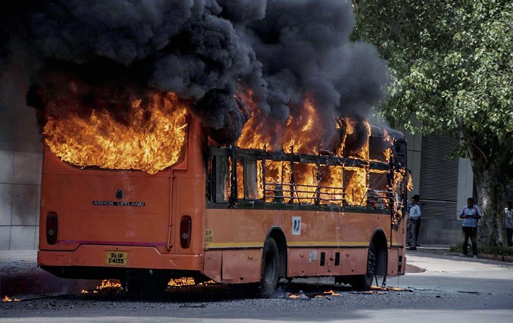 A DTC bus catches fire outside the Shivaji Stadium in New Delhi.