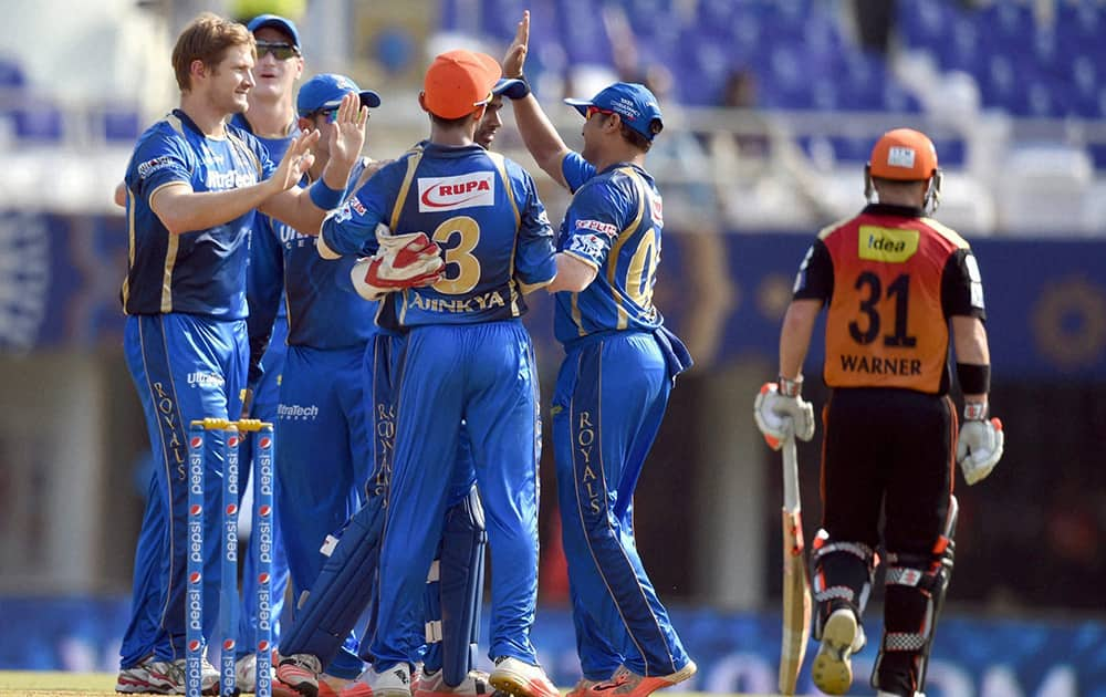 Rajasthan Royals players celebrate the wicket of SRHs David Warner during their IPL match in Mumbai.