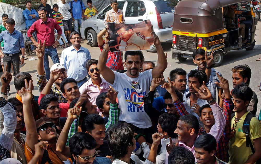 Fans of Bollywood actor Salman Khan gather outside his residence in Mumbai.