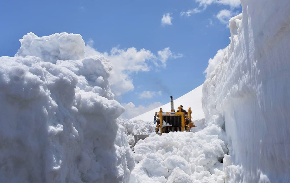 The snow is being cleared from Rohtang Pass on Manali - Keylong - Leh Highway.