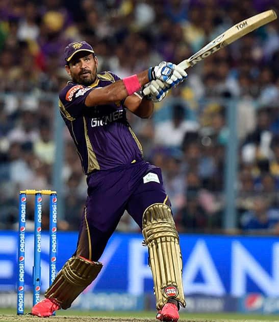 KKRs batsman Yusuf Pathan plays a shot during the IPL match aganist Delhi Daredevils at Eden Garden in Kolkata.