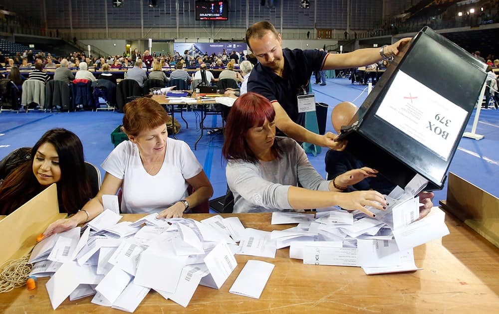 The first votes arrive at the general election count for the Glasgow constituencies at the Emirates Arena in Glasgow, Scotland.