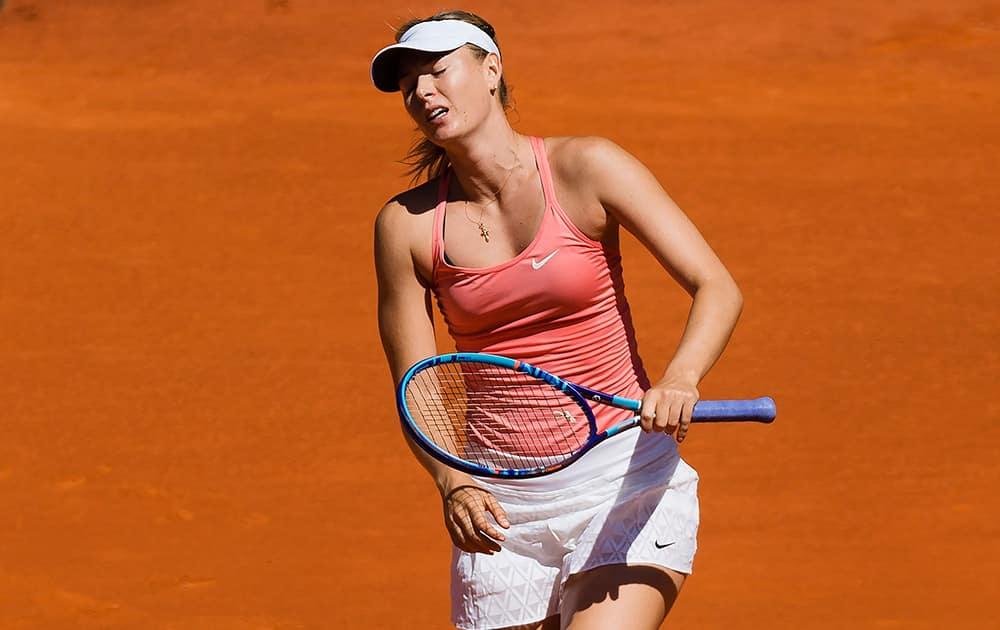 Maria Sharapova from Russia reacts during her Madrid Open tennis tournament match against Svetlana Kuznetsova from Russia in Madrid, Spain.
