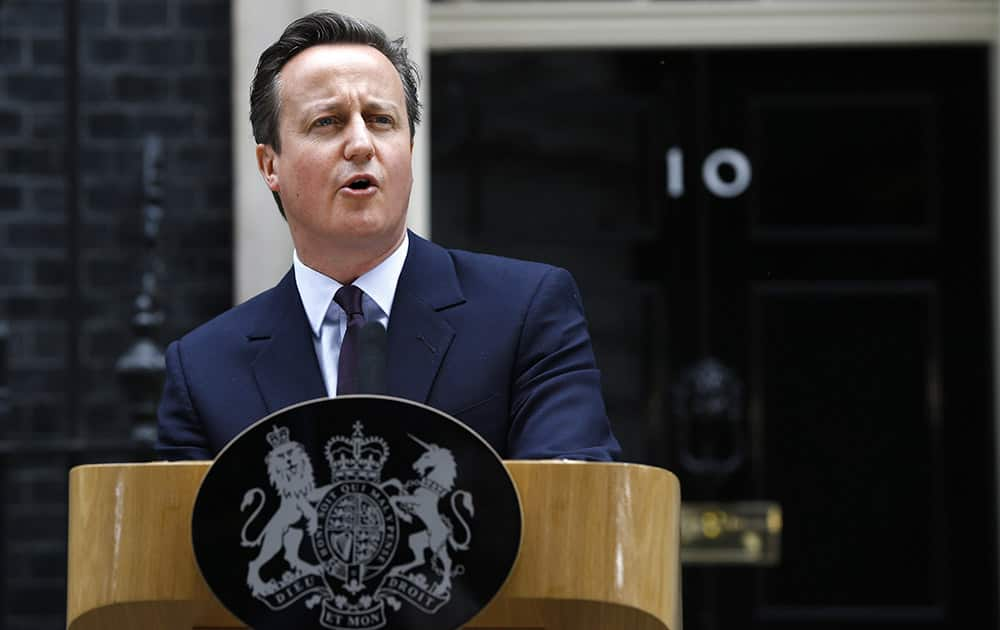 Britain's Prime Minister David Cameron speaks to the media in 10 Downing Street in London. Cameron's Conservative Party swept to power Friday in Britain's Parliamentary elections winning an unexpected majority.