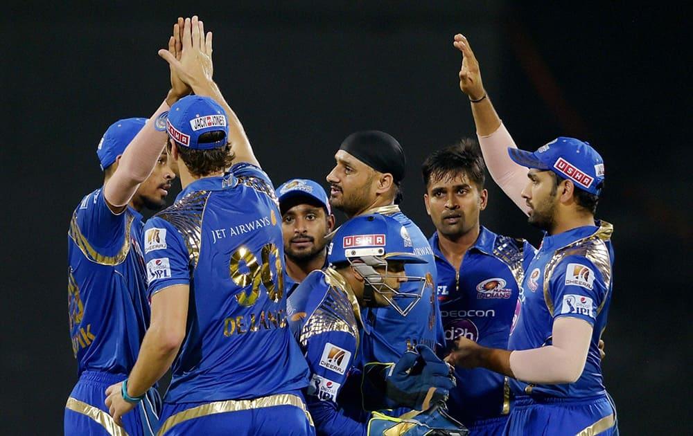 Mumbai Indian' Vinay Kumar celebrates along with teammates after dismissing a Chennai Super Kings Brendon McCullum during their IPL-2015 at MAC Stadium in Chennai.