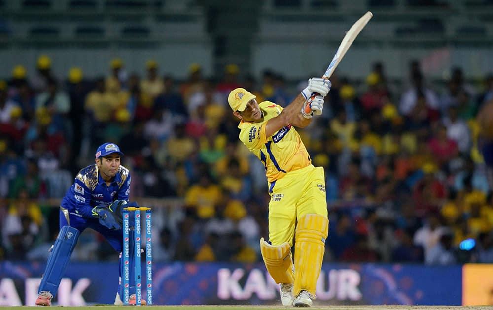 Chennai Super Kings' Skipper MS Dhoni plays a shot during the IPL-2015 match against umbai Indians at MAC Stadium in Chennai.