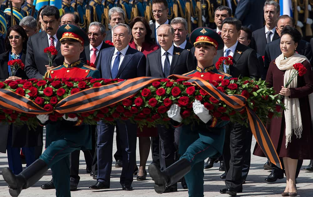 Venezuelan President's wife Cilia Flores, Venezuela's President Nicolas Maduro, Kazakh President Nursultan Nazarbayev, Russian President Vladimir Putin, Chinese President Xi Jinping and Chinese first lady Peng Liyuan attend a wreath-laying ceremony at the Tomb of the Unknown Soldier in Moscow after the Victory Parade marking the 70th anniversary of the defeat of the Nazis in World War II, in Red Square, Moscow, Russia.