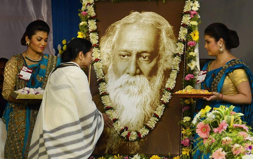West Bengal Chief Minister Mamata Banerjee pays homage to Nobel laureate poet Rabindra Nath Tagore on his 154th birth anniversary at Rabindra Sadan, Kolkata.