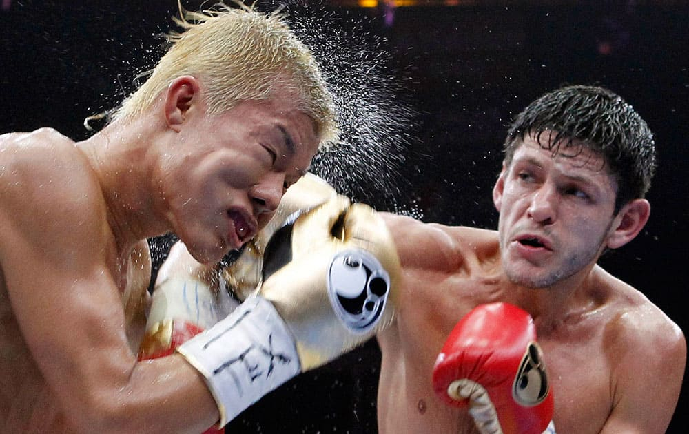 Tomoki Kameda, left, is struck by Jamie McDonnell during the eighth round of their bantamweight bout, in Hidalgo, Texas. McDonnell won the bout.