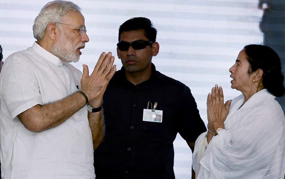 Prime Minister Narendra Modi and West Bengal Chief Minister Mamata Banerjee during the dedication ceremon of the Modernized and expanded IISCO Steel Plant to the nation at Polo Ground in Asansol.