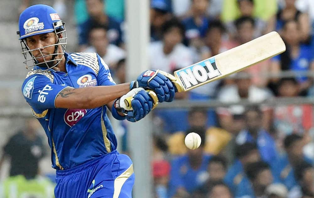 Mumbai Indians batsman Lendl Simmons plays a shot against Royal Challengers Bangalore during an IPL T20 match in Mumbai.