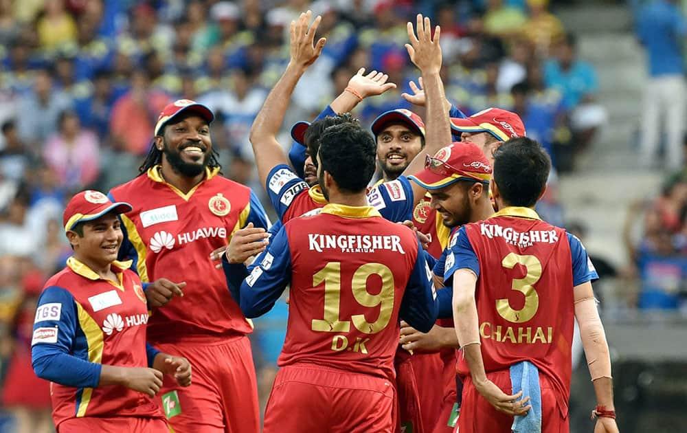 Royal Challengers Bangalore players celebrate a wicket of Mumbai Indians batsman Rohit Sharma during an IPL T20 match played in Mumbai.