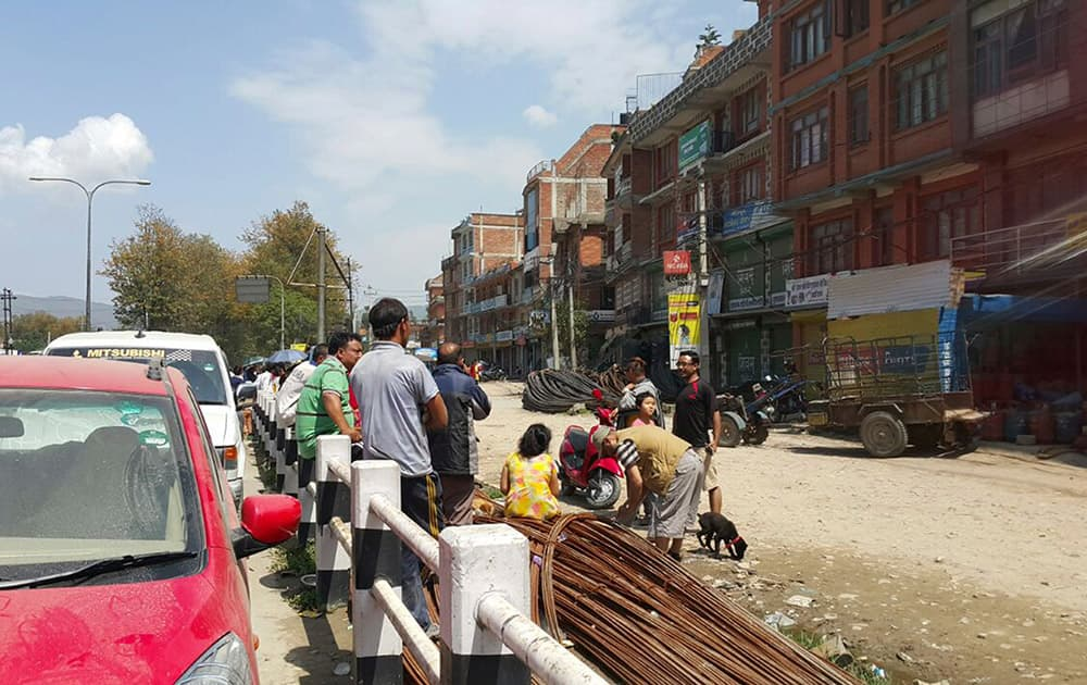 Nepalese people gather outdoors after another earthquake in Bhaktapur, Nepal.