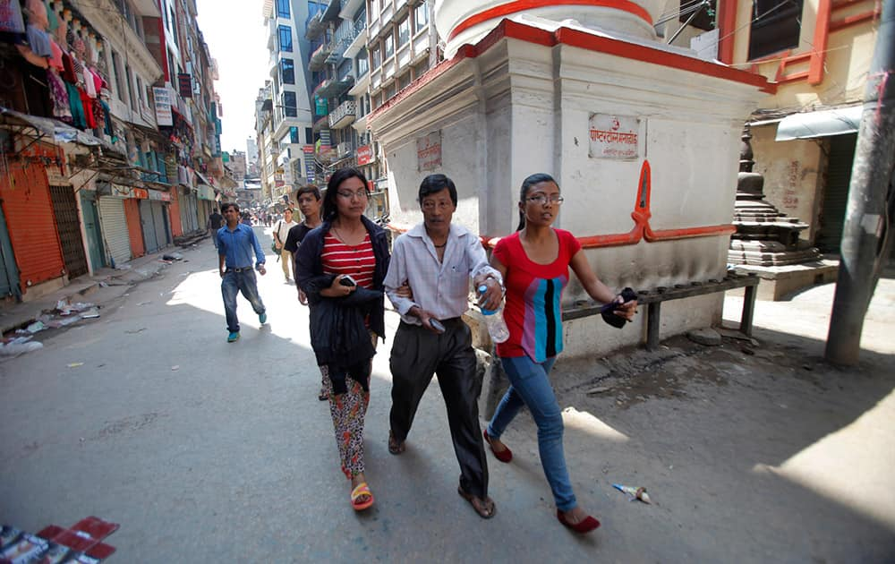 Nepalese people rush to safety after an earthquake hit Nepal in Kathmandu, Nepal.