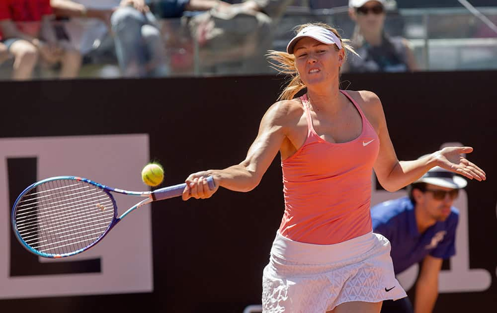 Russia's Maria Sharapova returns the ball to Australia's Jarmila Gajdosova during their match at the Italian Open tennis tournament, in Rome.