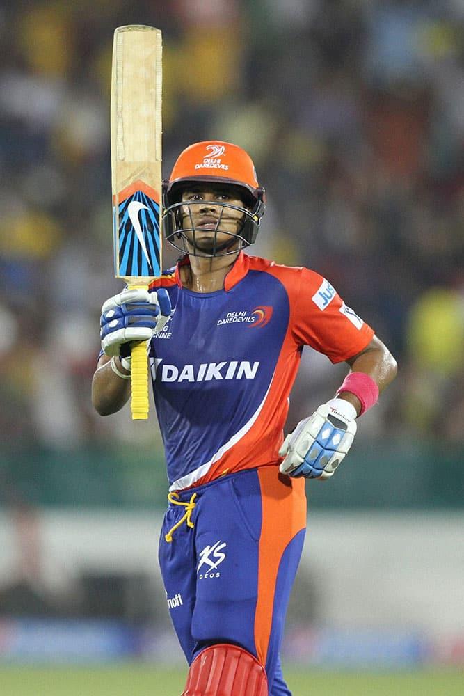 Shreyas Iyer of the Delhi Daredevils raises his bat after scoring 50 runs during an IPL 8 match against Chennai Super Kings in Raipur.