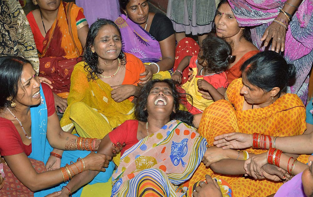 Women mourn the death of a family member after a wall collapsed in an earthquake in Danapur, on the outskirts of Patna, in the eastern Indian state of Bihar.