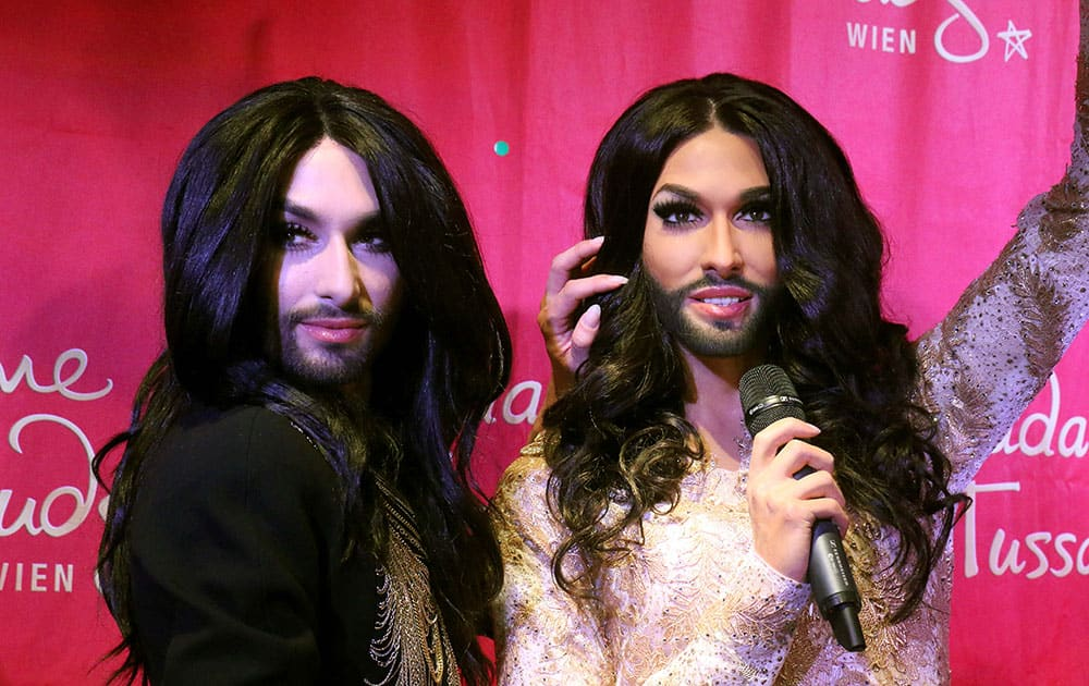 onchita Wurst, Austrian winner of the Eurovision Song Contest 2014,  unveils his wax figure at Madame Tussauds in Vienna, Austria.