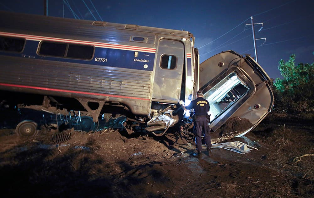 Emergency personnel work the scene of a deadly train wreck, in Philadelphia. An Amtrak train headed to New York City derailed and crashed in Philadelphia.