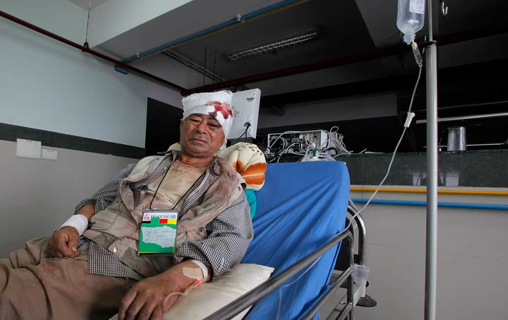 Bala Ram Nakarmi, 77, who was injured in Tuesday's earthquake, receives treatment at the Bir hospital in Kathmandu, Nepal.