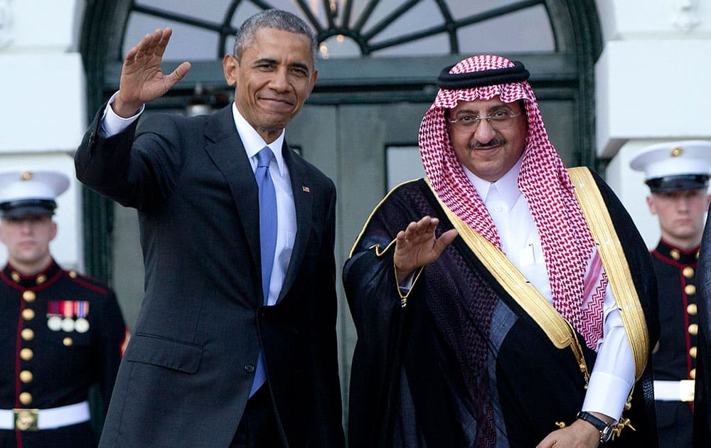 President Barack Obama, left, and Crown Prince Mohammed bin Nayef bin Abdulaziz Al Saud, Deputy Prime Minister and Minister of the Interior of the Kingdom of Saudi Arabia, wave to media as Mohammed bin Nayef bin Abdulaziz Al Saud arrives at the South Lawn of the White House in Washington.