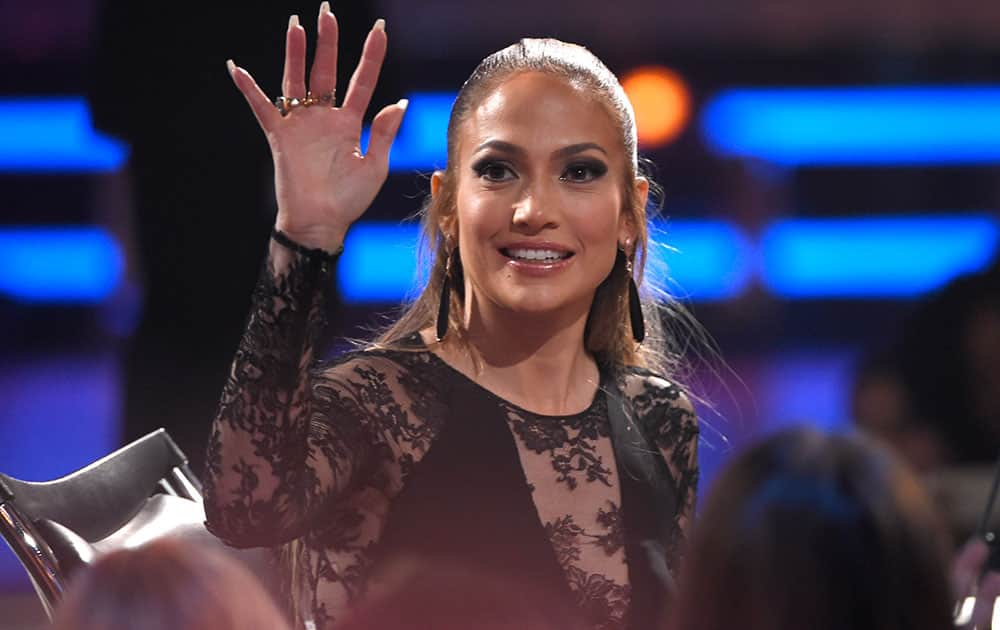Jennifer Lopez waves to fans at the American Idol XIV finale at the Dolby Theatre in Los Angeles.