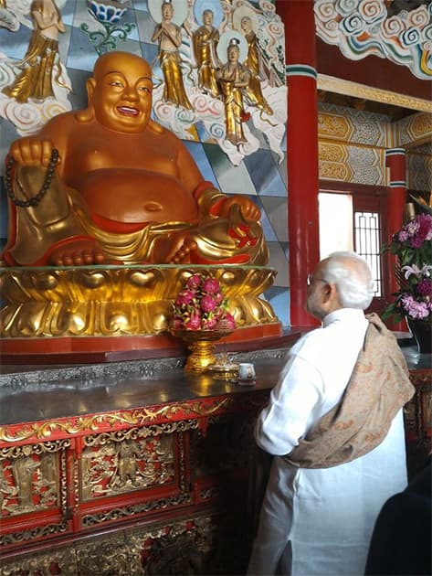Traversing centuries. From the 2nd century BCE to 2nd century CE. PM @narendramodi at Daxingshan temple . Twitter@PIB_India