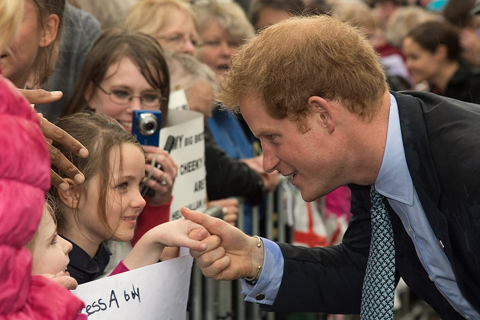 Britain's Prince Harry, shakes hands with a young girl while visiting the War Memorial Centre in Whanganui, New Zealand.