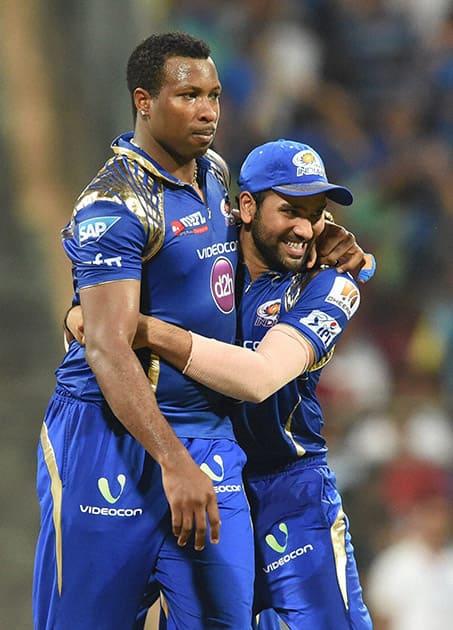 Mumbai Indians players K Pollard and Rohit Sharma celebrate their win against Kolkata Knight Riders during an IPL T20 match in Mumbai.