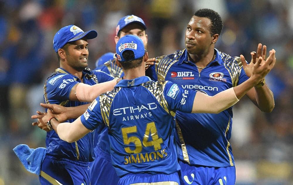 Mumbai Indians players celebrate their win against Kolkata Knight Riders during an IPL T20 match in Mumbai.
