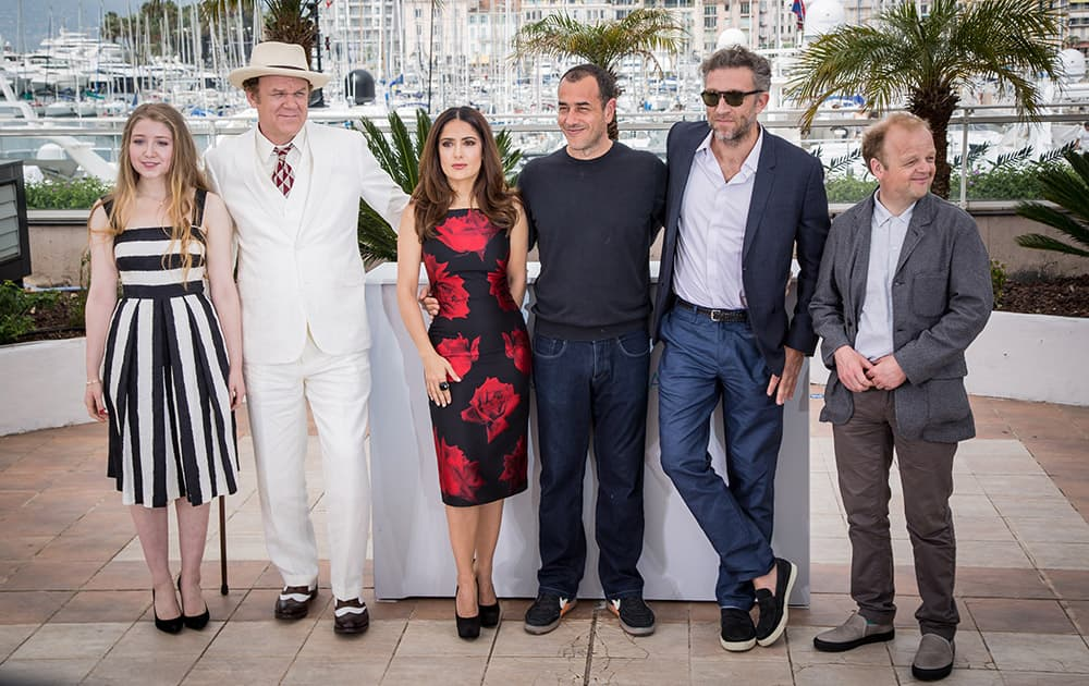 Bebe Cave, John C. Reilly, Salma Hayek, director Matteo Garrone, Vincent Cassel and Toby Jones from left to right pose for photographers during a photo call for the film Tale of Tales, at the 68th international film festival, Cannes, southern France.