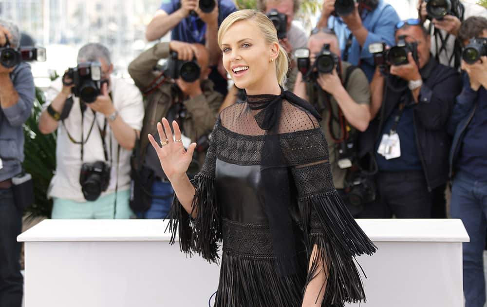 Charlize Theron pose for photographers during a photo call for the film Mad Max : Fury Road, at the 68th international film festival, Cannes, southern France.