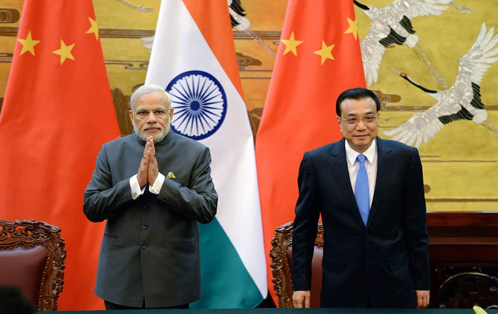 Chinese Premier Li Keqiang and Indian Prime Minister Narendra Modi attend a signing ceremony at the Great Hall of the People in Beijing, China.
