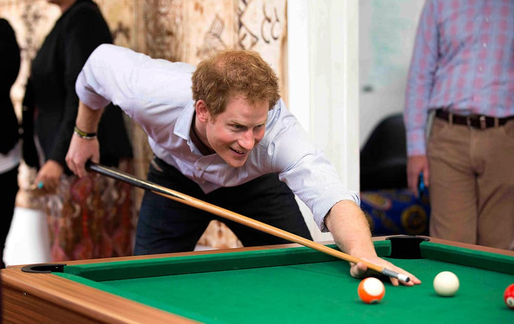 Britain's Prince Harry plays pool while visiting the Turn Your Life Around youth center in Auckland, New Zealand.