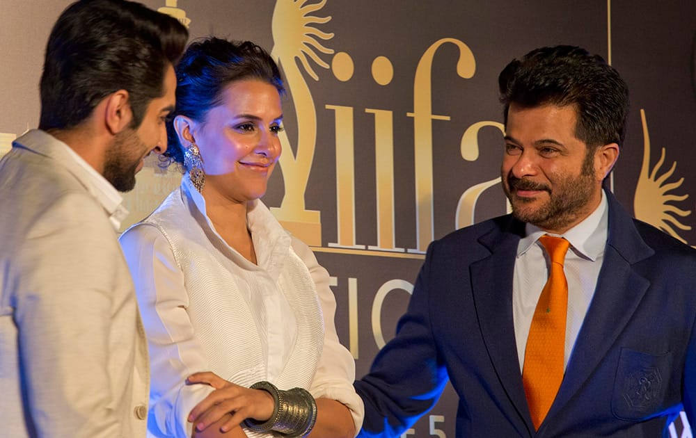 Ayushmann Khurrana, Neha Dhupia and Anil Kapoor attend a press conference held to announce the International Indian Film Academy award ceremony to be held in Kuala Lumpur in June, in New Delhi.