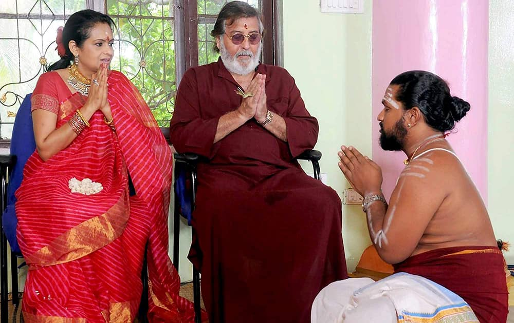 Vinod Khanna and his wife Kavitha perform a puja to celebrate their 25th wedding anniversay in Bengaluru.