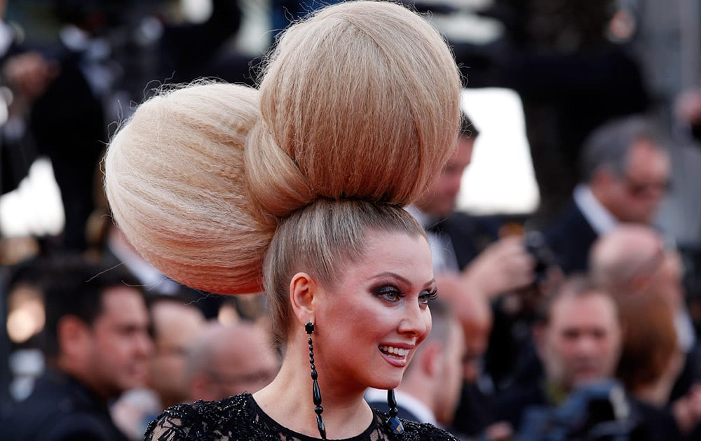 Television personality Elena Lenina pose for photographers as she arrives for the screening of the film Irrational Man at the 68th international film festival, Cannes, southern France.