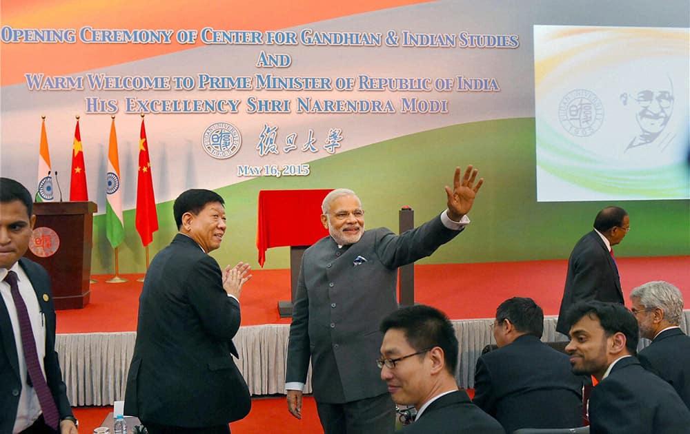 Prime Minister Narendra Modi waves during opening ceremony of Centre for Gandhian & Indian Studies at Fudan University in Shanghai.
