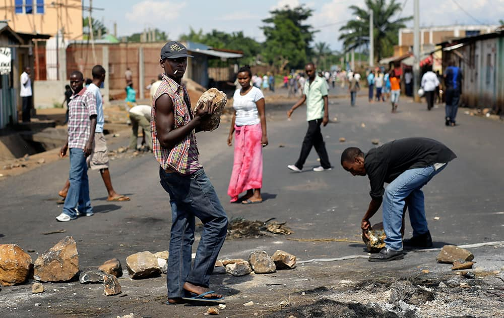 Demonstrators opposed to President Pierre Nkurunziza's bid for a third term in office rebuild a barricade after it was dismantled by soldiers in the Nyakabiga neighborhood of Bujumbura, Burundi.