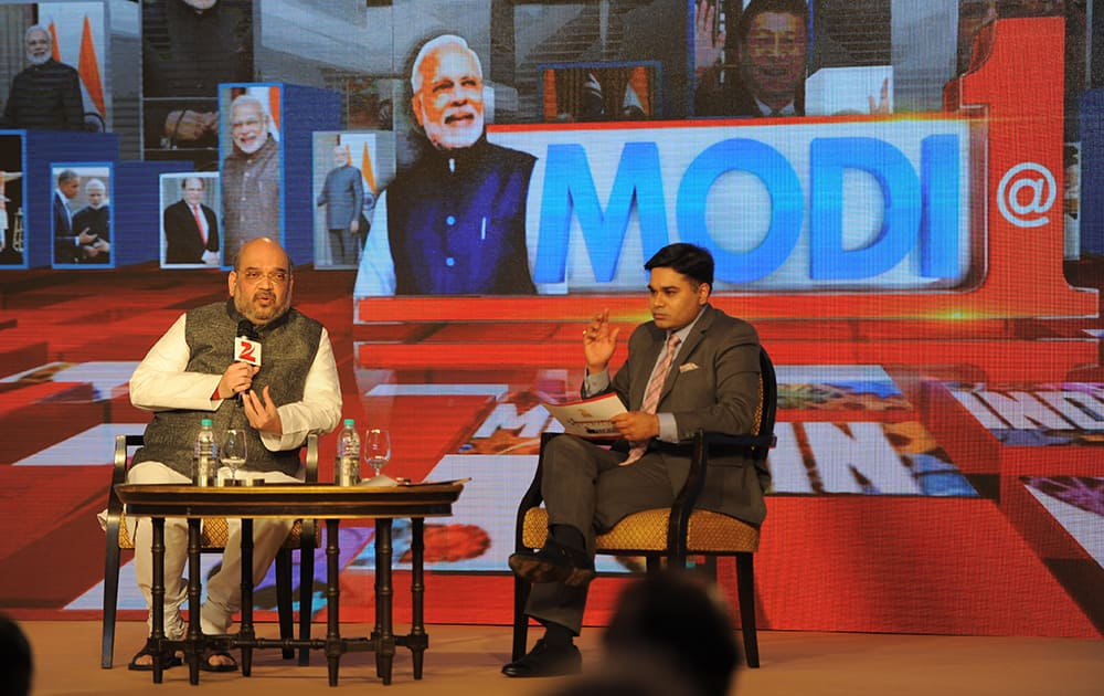 BJP president Amit Shah in conversation with Zee Business editor Amrish Devgan as part of the Ministerial Conclave held to evaluate one year of BJP in power. Speaking of the achievements of the various schemes taken up by the NDA government, Shah said that development will roll out in cumulative effects. Apart from him, ministers Nitin Gadkari, Rajiv Pratap Rudy, Mahesh Sharma, Suresh Prabhu, Ravi Shankar Prasad and Jitendra Singh took part in the discussions.- DNA