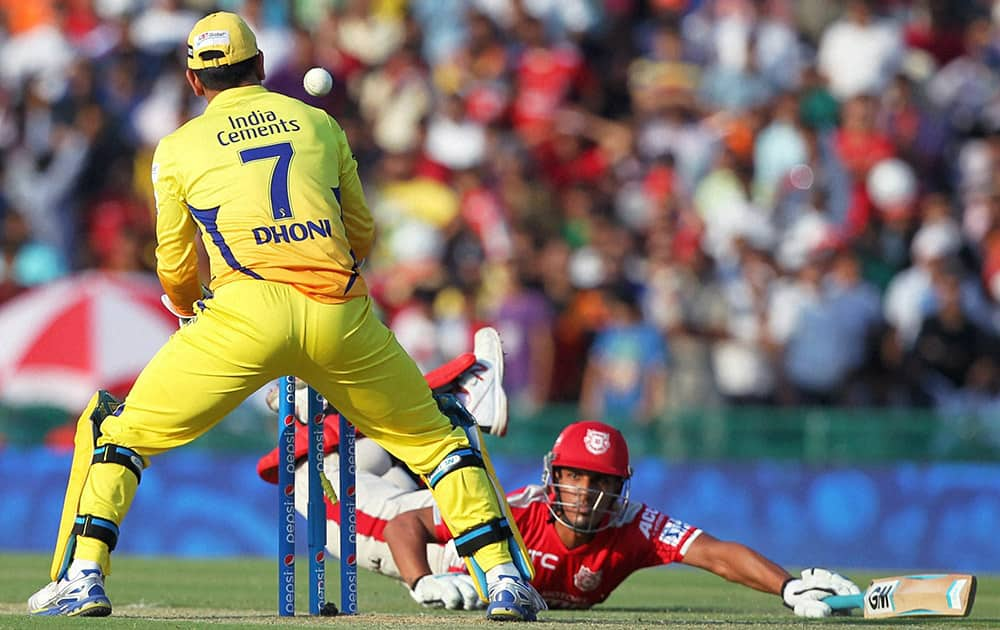Skipper MS Dhoni of Chennai Super Kings attempts to scatter stumps during the IPL match against Kings XI Punjab in Mohali.